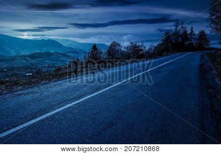 Countryside Road Through Mountains At Night