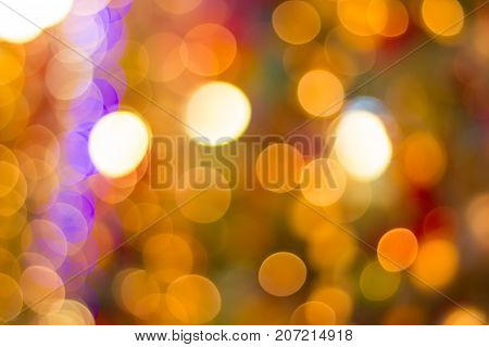 bokeh Decorative outdoor string lights hanging on tree in the garden at night time - decorative christmas lights - happy new year