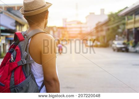 Portrait of African man backpack traveling in old city of Asia.