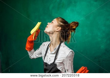 funny cute girl doing cleaning in orange gloves