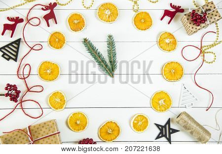 Christmas evening offensive 12 am - a symbol in the form of a clock from dried oranges and fir branches