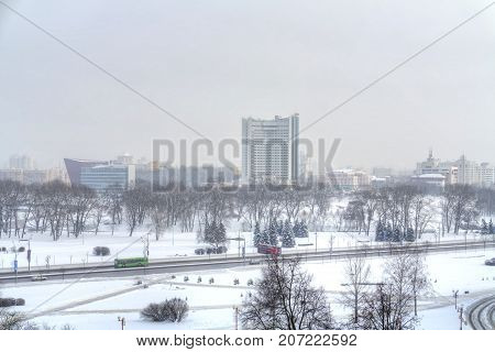 MINSK REPUBLIC OF BELARUS - January 18.2017: Park Starostinskaya Sloboda and uptown. The view from the heights. Snowfall