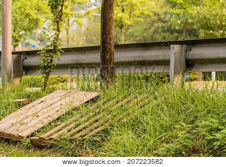 Wooden Pallets Laying In The Grass