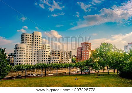 Looking at Media Harbor at Rhine-River in Dusseldorf in Germany. Media Harbor skyline among greenery of the city. Beautiful and colorful cityscape