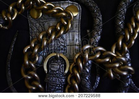 gold chain on the background of the texture of the skin