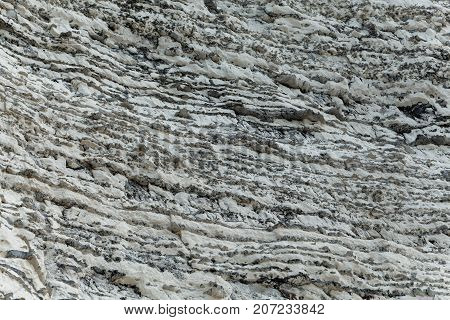 Layers Of Dark Flint Pebbles In Limestone