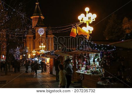 TIMISOARA ROMANIA - DECEMBER 14 2016: Aspects from the Christmas fair with traditional products and specific night atmosphere.
