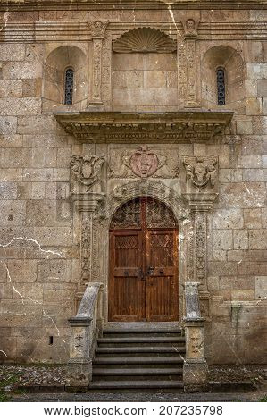 Old photo with part of the lateral wall and small entrance to the Saint Michael Roman Catholic Cathedral in Carolina White Fortress of Alba Iulia City Romania.Vintage processing.