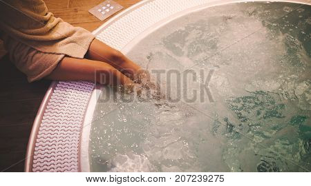 Woman enjoying hot tub in spa after sauna