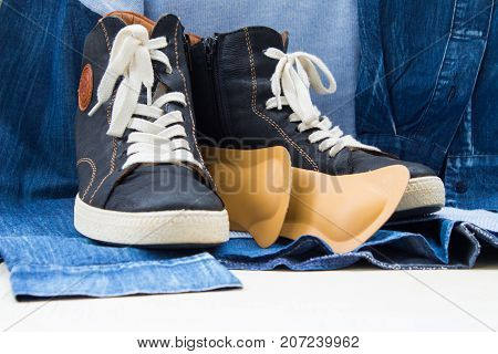 Women's Blue Boots With A White Lacing With Orthopedic Insoles. Background  Of Blue Sweatshirt