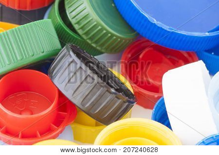 Colorful plastic bottle caps closeup recycled garbage