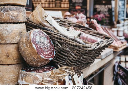 LONDON, UK - SEPTEMBER 30, 2017: Selection of meat products on a Taste Croatia market stall in Borough Market, one of the largest and oldest food markets in London.