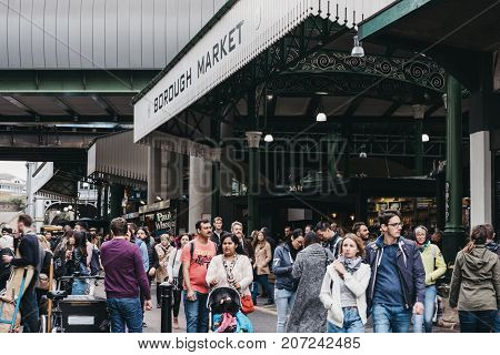 LONDON, UK - SEPTEMBER 30, 2017: People by the entrance of Borough Market, one of the largest and oldest food markets in London.