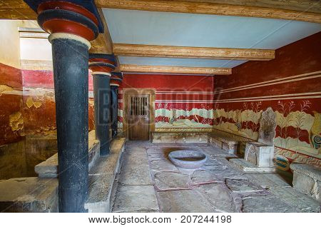 Heraklion, Greece - January 28, 2017: The hall of throne, at the palace of Knossos, famous ancient city in Crete, located near modern Heraklion city