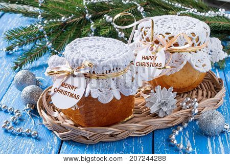 Original pie with caramelized apples is baked in jars. Christmas present. Inscription on the label: Merry Christmas. Sweet and delicious gift for holiday. Canned bakery product stored for long time
