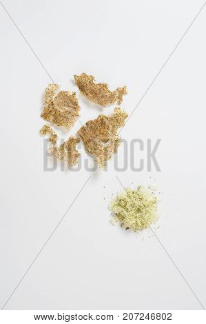 Pounded coriander mixed with remnants of rice that remain in bottom of the rice cooker pot including before and after dehydrated by sunlight. Zero-waste kitchen idea concept