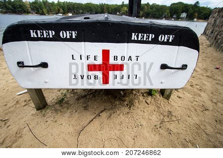 Harrison, Michigan, USA - October 3, 2017: Aluminum rescue lifeboat on the shores of Budd Lake in Wilson State Park in the Lower Peninsula of Michigan.