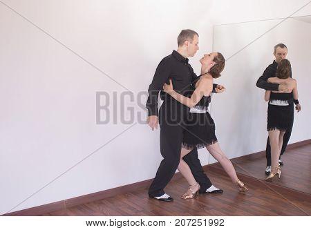 Couple Of Dancers Dancing Latin Dances