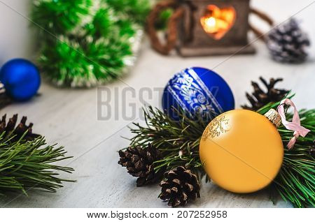 Christmas decoration : colorful balls, candle, garland, pine tree and bumps