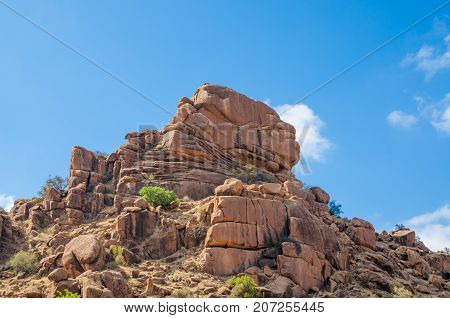 Red rocky landscape in atlas mountain region of Morocco, North Africa.