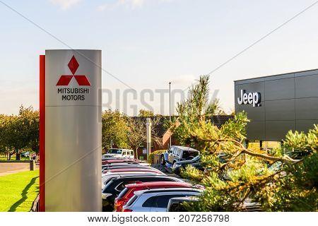 Northampton Uk October 3, 2017: Mitsubishi Motors And Jeep Logo Sign Stand Northampton Industrial Es