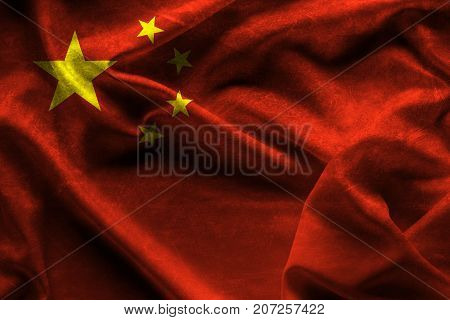waving fabric flag of China Background and texture.