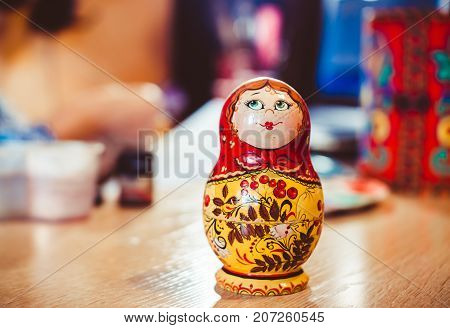 Russian nesting doll standing on the table artist
