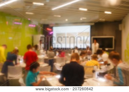 Defocused photo of schoolchildren on chemistry class in lesson