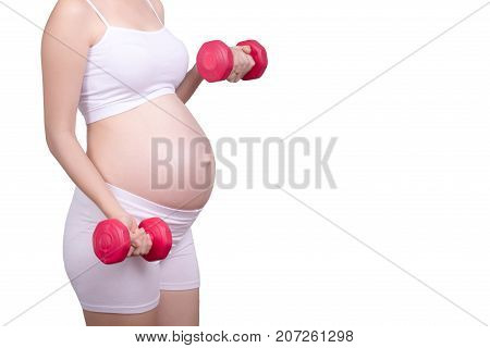Pregnant exercises concept.A portrait of a Beautiful asian pregnant woman doing light exercise by using dumbbell isolated on white background with clipping path. Anonymous face Asia female in her 20s