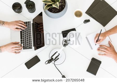 Men Working With Laptop And Notepad