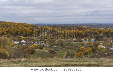 Autumnal landscape with small remote hamlet Kharkivshchyna in Sumskaya oblast Ukraine