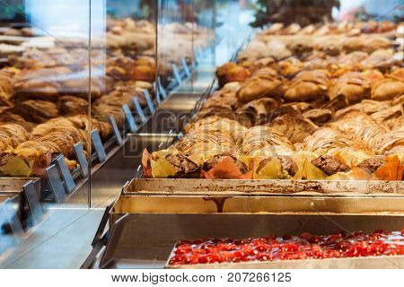 Variations croissants and other pastries exhibited in shop window