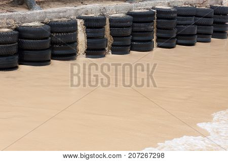 Rubber tires wall on the beach for breakwater