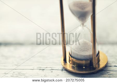 time is ticking - hourglass on the table with copy space