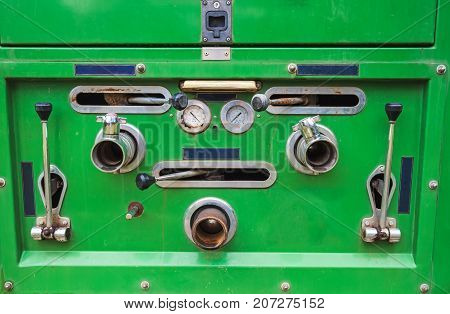 Close up of dials and controls on antique rusting fire truck