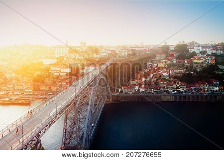 old town of Porto and bridge of Dom Luis I at sunset, constructed in 1886, Portugal, retro toned