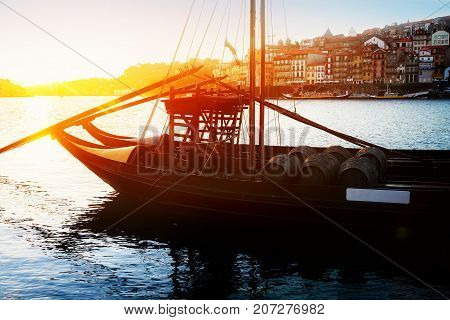 Douro river and traditional port wine boats at sunset, Portugal, retro toned
