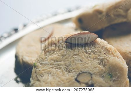 Stock photo of Soan Papdi or Soan roll or Patisa or patisha, popular sweet from India. selective focus