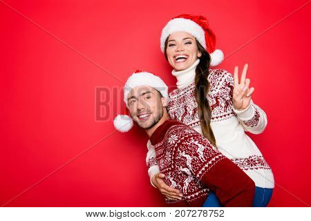 Adorable Sweet Cute Cheerful Partners In Knitted Traditional Clothing, Head Wear, Showing V Gesture,