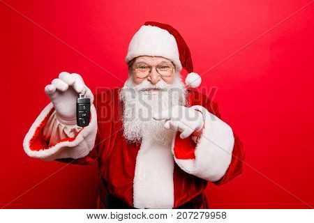 Success happiness dream december buyer ownership property purchase rent sell truck cars concept. Funny aged grandfather in red traditional outfit and headwear. X mas noel surprise time!