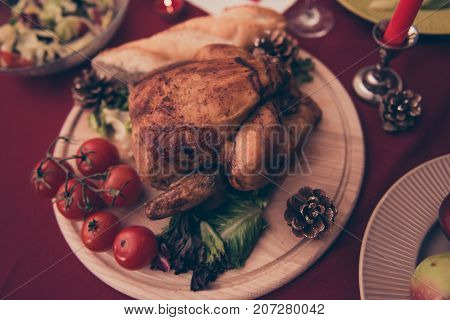 Close Up Top Up View Of Served Roasted Stuffed Small Turkey And Fresh Yummy Vegetables, On Light Rou
