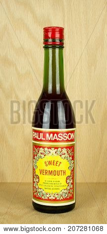RIVER FALLS,WISCONSIN-OCTOBER 04,2017: A bottle of Paul Masson brand sweet vermouth with a wood background.