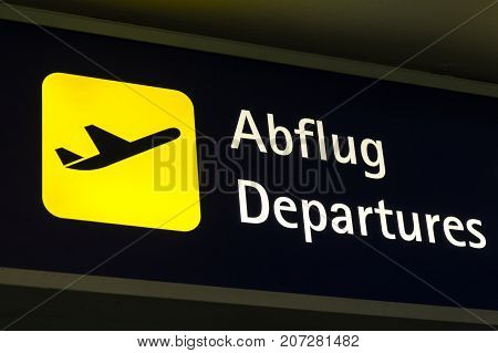 Yellow Departures Sign In German And English