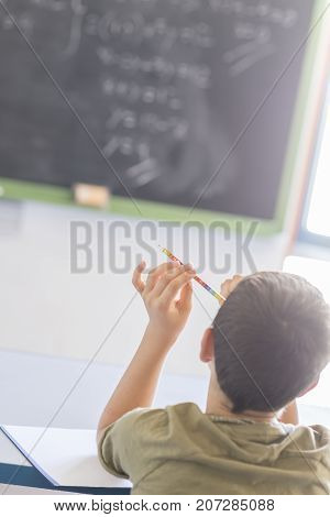 Student Attending In A  Classroom During A Lesson