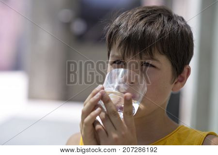 Child Drinking A Glass Of Pure Water