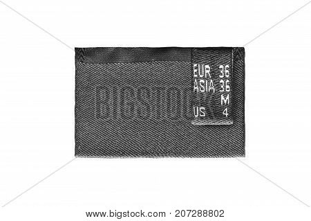 Black textile clothes label medium size isolated over white