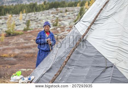 nomad man outside his yurt in northern Mongolia