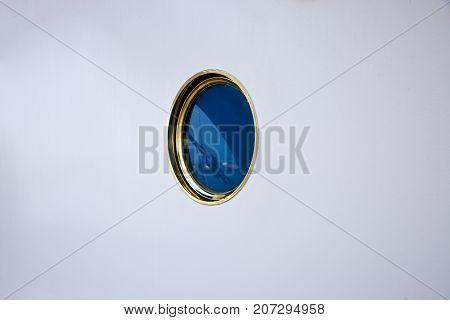 Single Porthole On A White Wall On A Ship