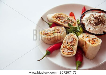 hot spicy armenian shawarma on plate with pepper