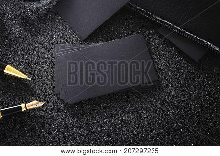 Blank black business card mock up black background for use us contact information design templete.